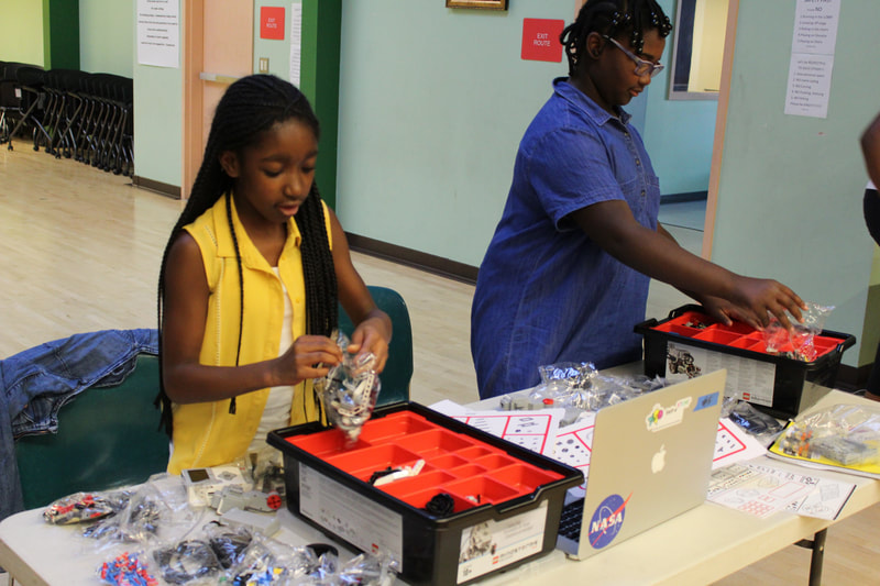 Young ladies preparing for Lego Robotics competition